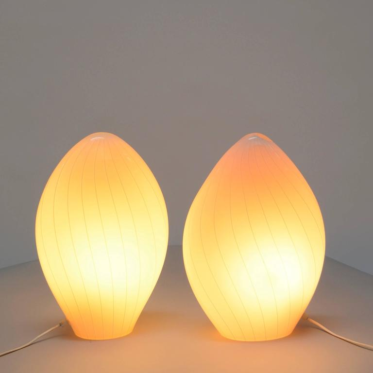 An excellent pair of Vetri Murano translucent white table lamps in perfect condition. Featuring a handblown spiral swirled glass shade. Made in Italy.