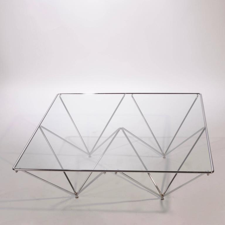 Architectural coffee table 'Alanda' in the style of Paolo Piva for B&B, Italia. Chrome wire metal frame with cut-glass top.