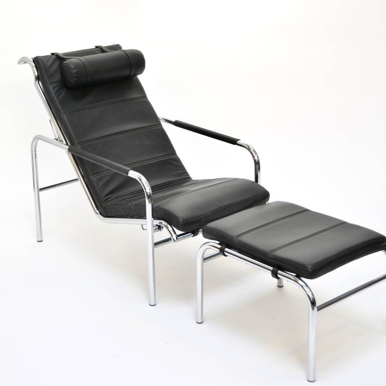 This is a showroom condition Genni lounge chair and ottoman designed by Gabriele Mucci in 1935. It is constructed using a chromium-plated steel tube frame. The cushion, armrest covers and headrest are polyurethane upholstered in your black leather.