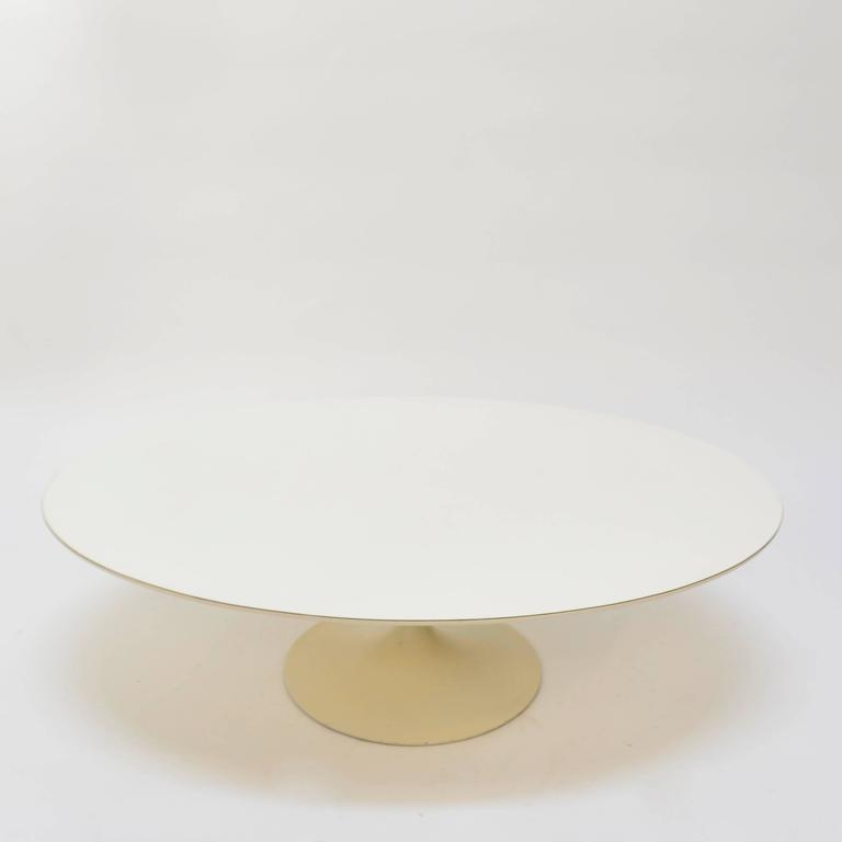 Very early cast iron base coffee table by Eero Saarinen for Knoll, white laminate top.