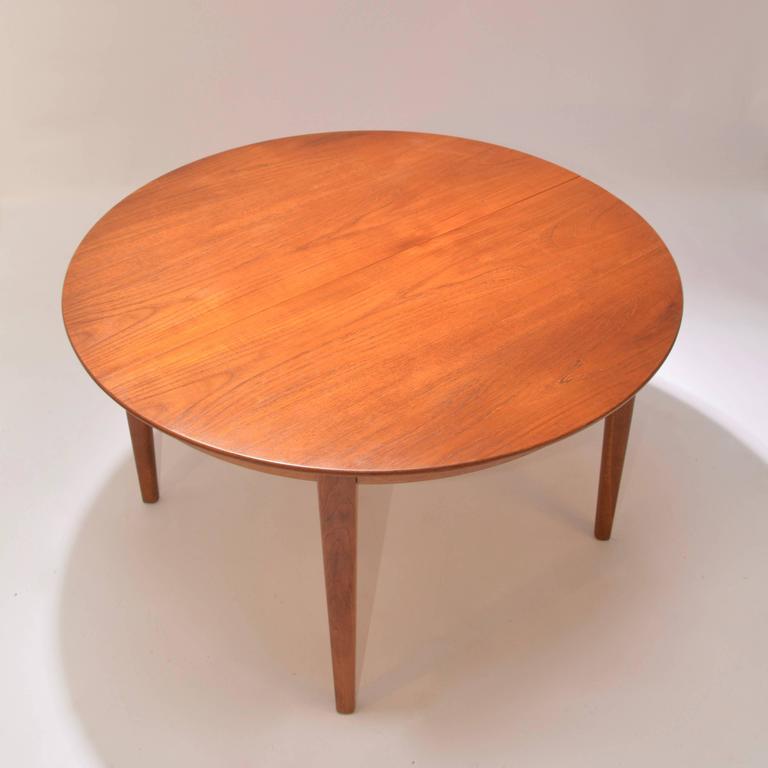 Scandinavian Modern Henning Kjaernulf Teak Round Table with One Leaf For Sale