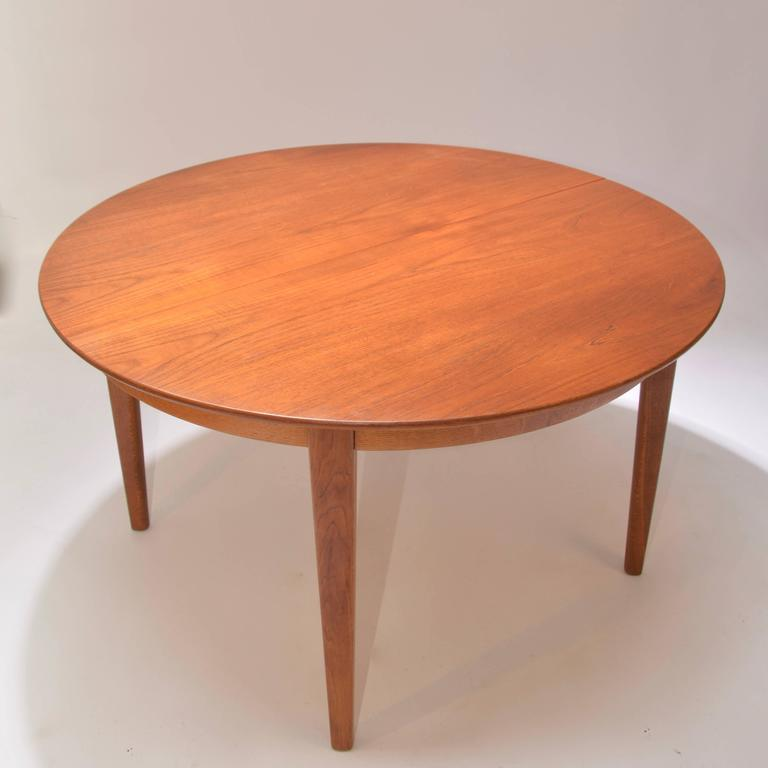 Danish Henning Kjaernulf Teak Round Table with One Leaf For Sale