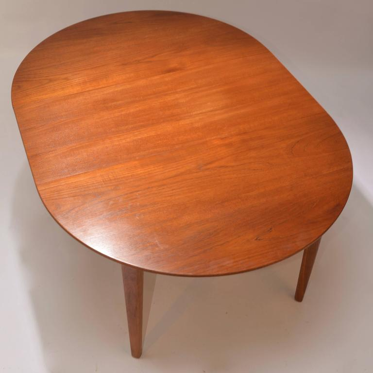 Mid-20th Century Henning Kjaernulf Teak Round Table with One Leaf For Sale