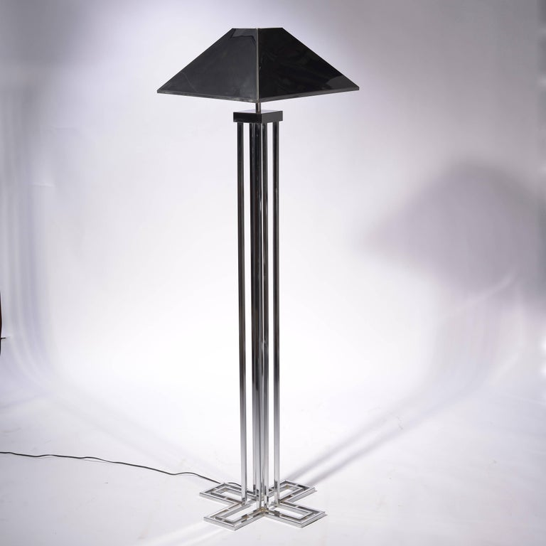 A Curtis Jere chrome floor lamp, signed on the base and the shade.