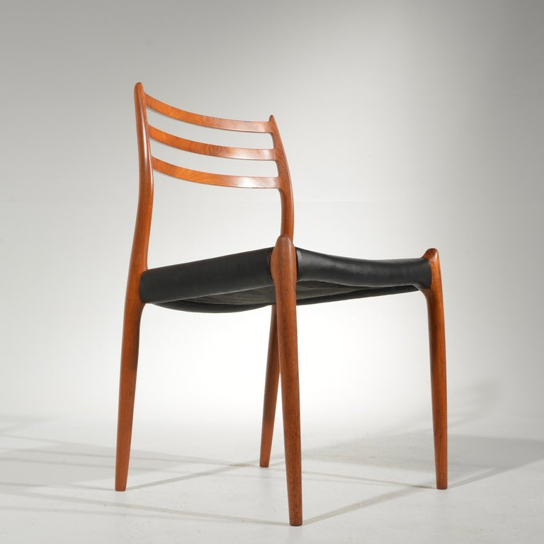Set of eight teak dining chairs designed by Niels Otto Møller for J. L. Møllers Møbelfabrik. The model 80 dates to 1968 and is an exceptional chair offering a very comfortable posture and the warm modern look typical of great Danish design. Shown in