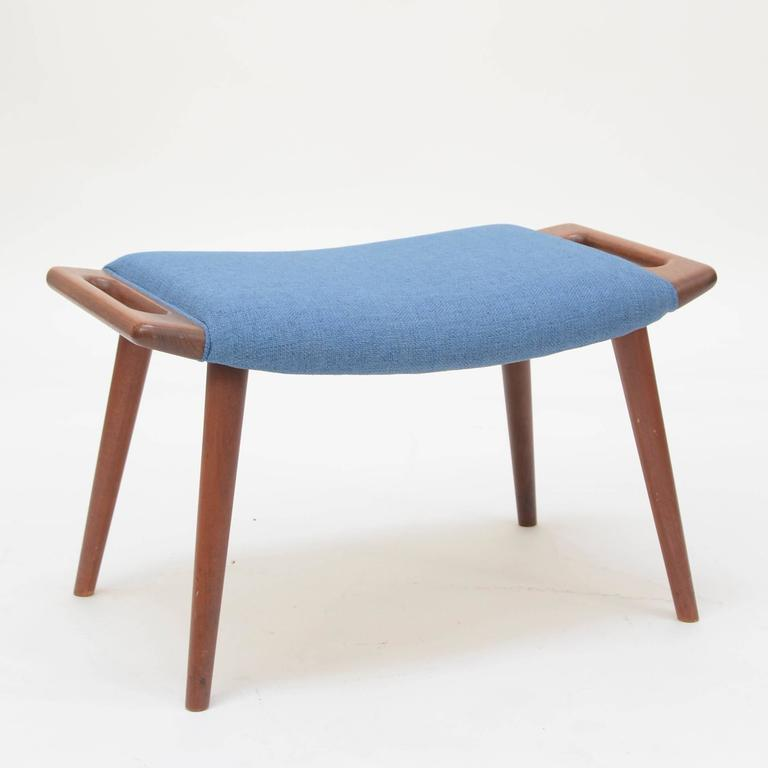Original 1950s solid teak stool with handles on each side on tapered legs. Stamped on bottom. Made by A.P. Stolen.