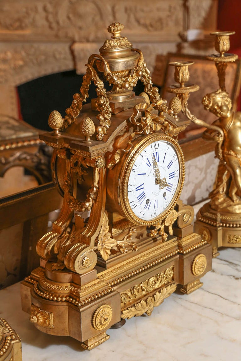 Gilt French 19th Century Three-Piece Bronze Doré Garniture Clock Set For Sale