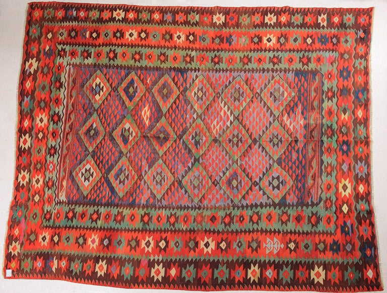 Very fine workmanship for this old Turkish kilim Sharkoy. Triumph of colors,