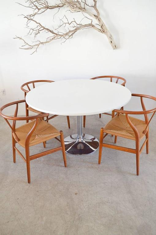 white laminate dining table by top extending oval