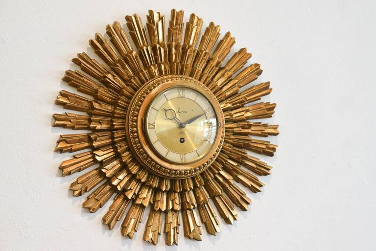 Gold Sunburst Clock by Syroco, circa 1955 at 1stdibs