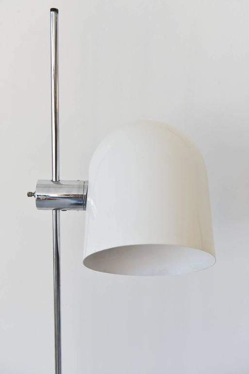 Standing floor lamp by Robert Sonneman, circa 1970. White enamel can light, chrome stem and pivoting head. Original wiring. Working condition.