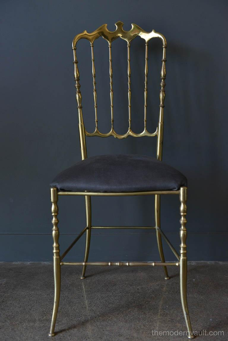 Original solid brass Chiavari chair made in Italy, circa 1970, beautiful lines, works in almost any setting. Some slight patina to base as shown, otherwise good original condition. New fabric on seat.