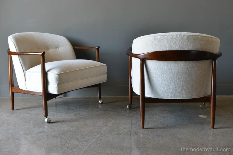 Finn Andersen for Selig Denmark sculpted barrel back lounge chairs, circa 1960. Sculpted walnut frames with newly upholstered imported Italian brushed linen in off white/oatmeal color. Beautiful walnut frames have been professionally restored.