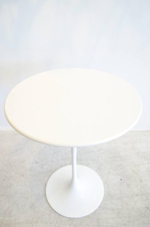 Original Saarinen for Knoll tulip side table in excellent vintage condition.  White laminate top, one small wear mark, as shown, otherwise perfect.  Cast iron base is excellent with no chips or marks.  Measures 16' Diameter x 20