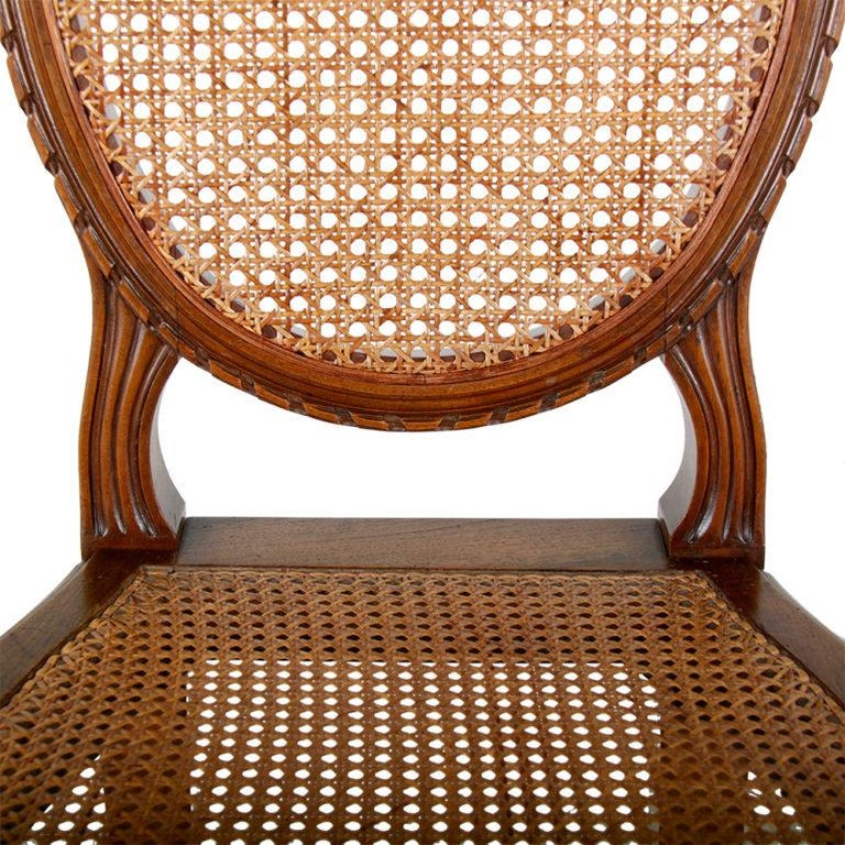 Carved Set of Six Louis XVI-Style Cane Dining Chairs For Sale