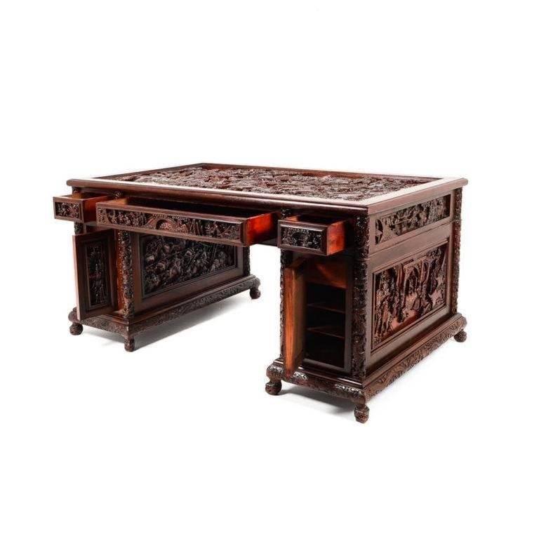 Monumental antique Chinese hardwood desk. These desks were made in China  specifically for export to - Antique Chinese Intricately Carved Hardwood Desk, Circa 1910 At 1stdibs