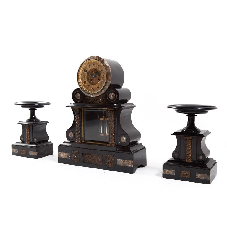 Antique French marble and bronze mantel clock garniture set with two side pedestals, circa 1880.  Measures: Clock 15? wide x 5.5? deep x 19? tall. Pedestals 7.5? wide x 7.5? deep x 10.5? tall.