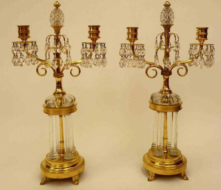 This pair of candelabra with bases in the form of miniature garden temples are attributed to William Parker and date from 1800. Parker supplied chandeliers to the Prince of Wales for Carlton House. See Martin Mortimer; The English glass chandelier,