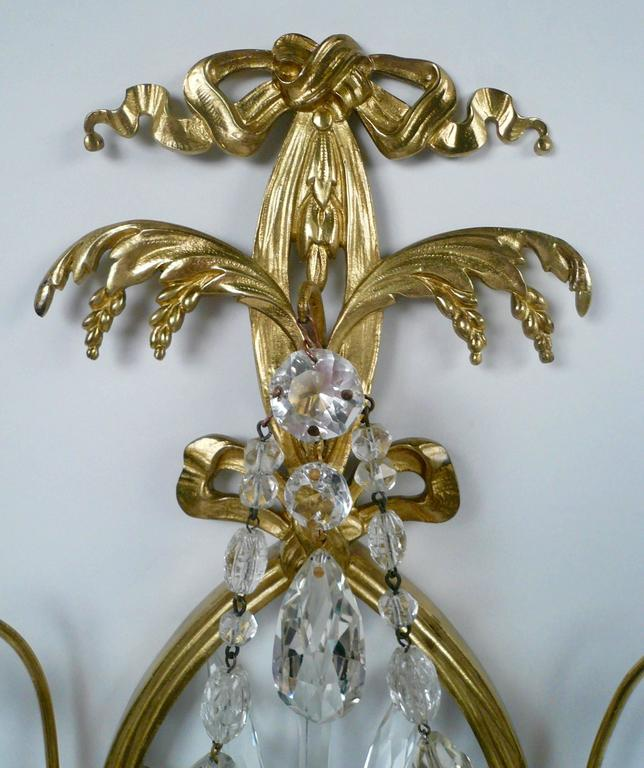 Neoclassical Pair of E. F. Caldwell Cut Crystal and Brass Two-Light Sconces For Sale