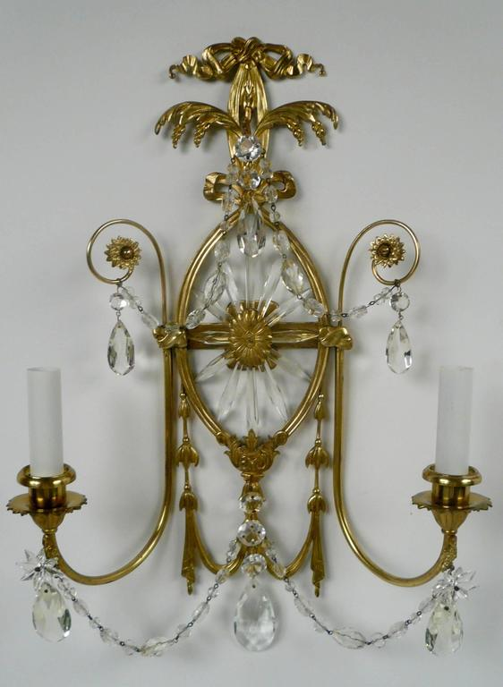 This pair of neoclassical style sconces with a Robert Adam design influence are well proportioned and in fine condition.