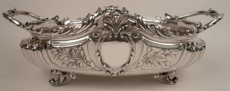 This grand silver plated bronze centerpiece bowl of sculptural form, has beautifully hand chased details.
