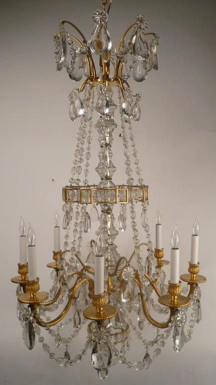 This Baccarat quality fixture is beautifully cast and hand chased in gilt bronze, and the prisms are of the finest quality. It was made in France, and retailed by Edward F. Caldwell.