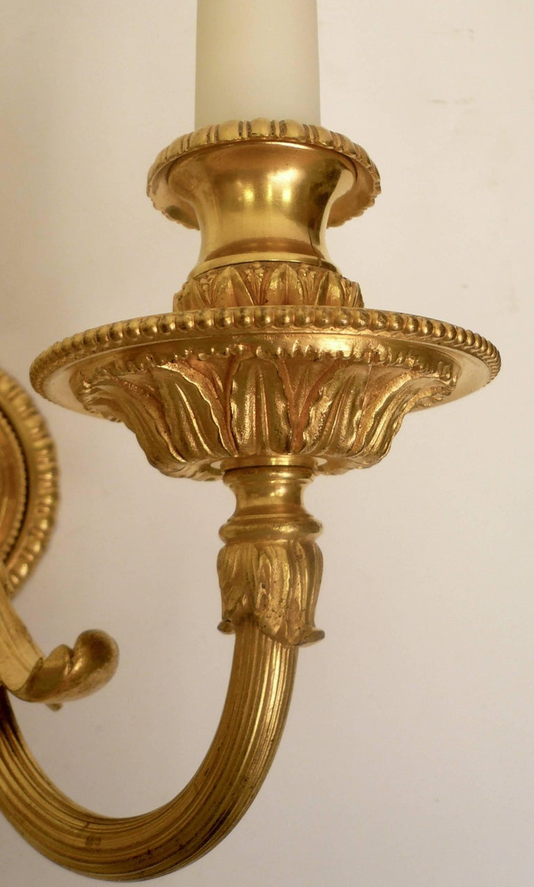 19th Century Pair of Neo-Cassical Gilt Bronze Three-Light Wall Sconces by E. F. Caldwell For Sale