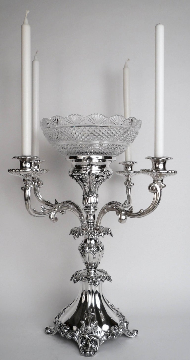This impressive centerpiece features foliate, and vintage motifs, acanthus leaves, and scroll form feet.