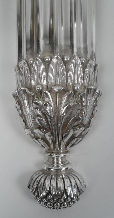 These twin arm neoclassical sconces feature Adam style decoration, including acanthus leaf, and urn form motifs. They have their original silver finish, which has been polished and re-lacquered.
