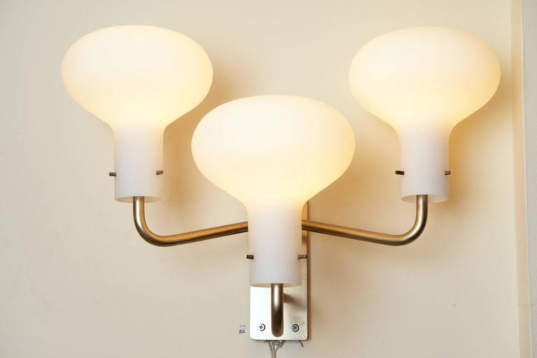 Large-scale Ignazio Gardella wall sconces. Pair available.