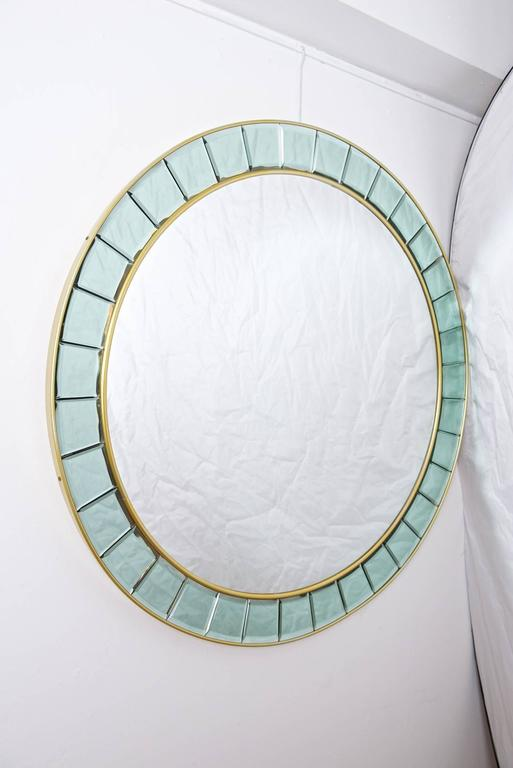 Round mirror. Style of Cristal Arte in excellent condition.