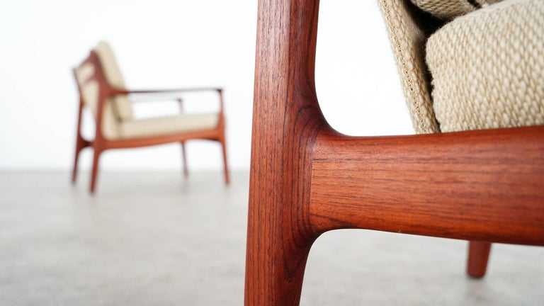 Two extremely rare Eugen Schmidt teak easy chairs for Soloform circa 1965, Germany.  Original woollen cushions, beautiful, handcrafted wood-details. Both chairs in mint condition! This sale is for both chairs.