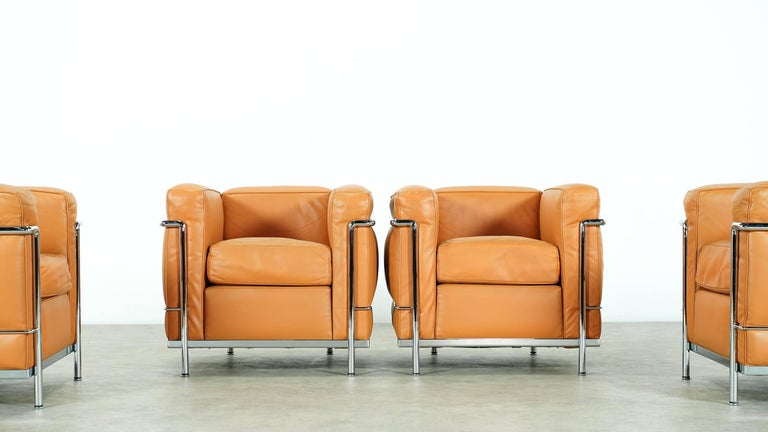 Set of two LC2 lounge chairs, designed by Le Corbusier, produced by Cassina.  Stamped and engraved, see photos cognac leather, beautiful condition! Some of the most comfortable seating designed by Le Corbusier ever. (two chairs are already sold).