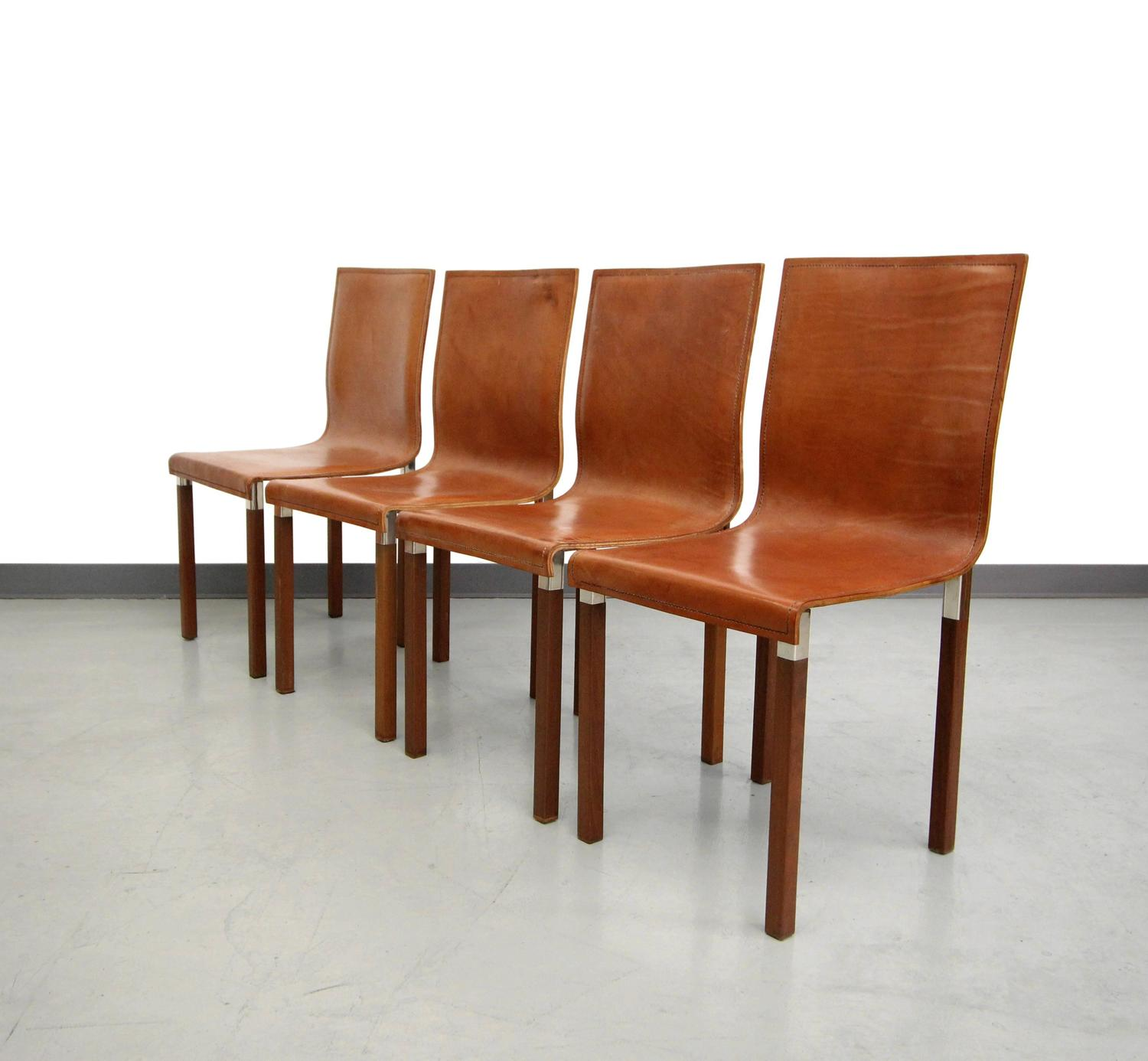 of four leather emile industrial modern dining chairs by zele company