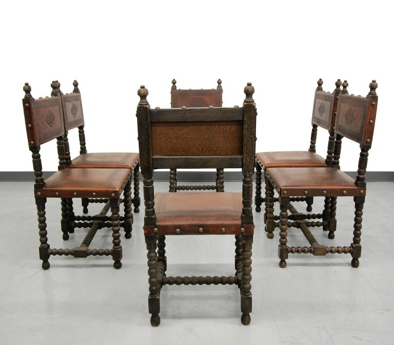 Gorgeous set of six early 20th century, antique Spanish Colonial dining  chairs. These chairs - Set Of Six Antique Spanish Colonial Stamped Leather Dining Chairs At