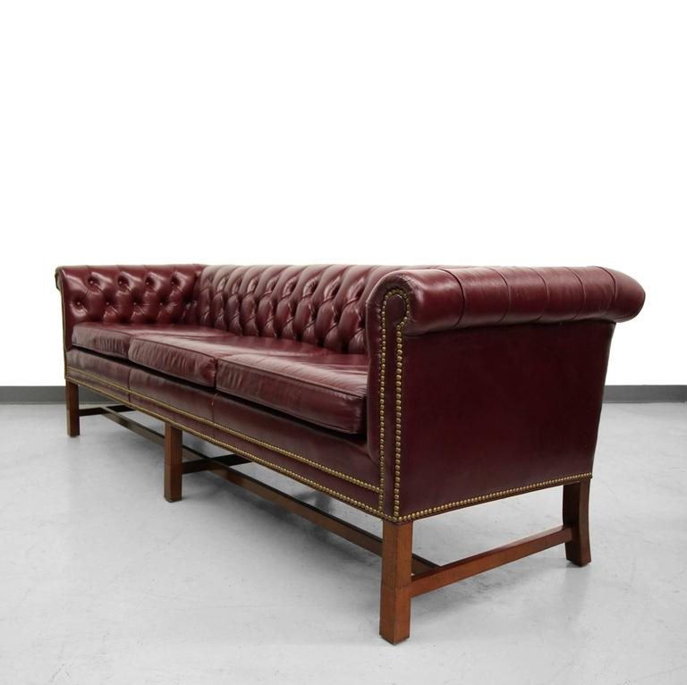 Perfect Chippendale Style Chesterfield Sofa. Dressed In A Deep Cranberry  Colored Leather And Perched Upon