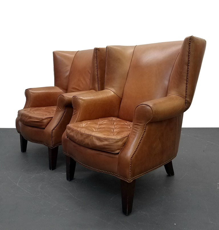Pair Of Oversized Vintage Leather Wingback Chairs For Sale