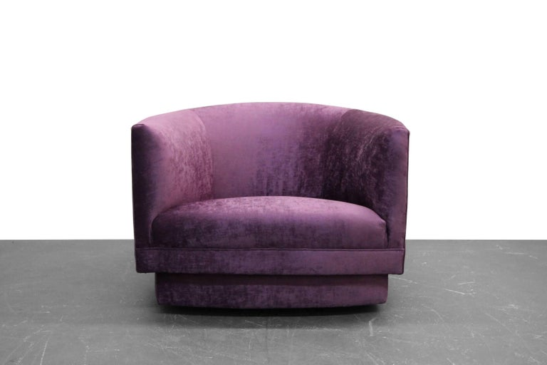 Great one off midcentury swivel chair by Milo Baughman. Great size chair in the perfect shade of purple. Love how the base is shaped to the chair.