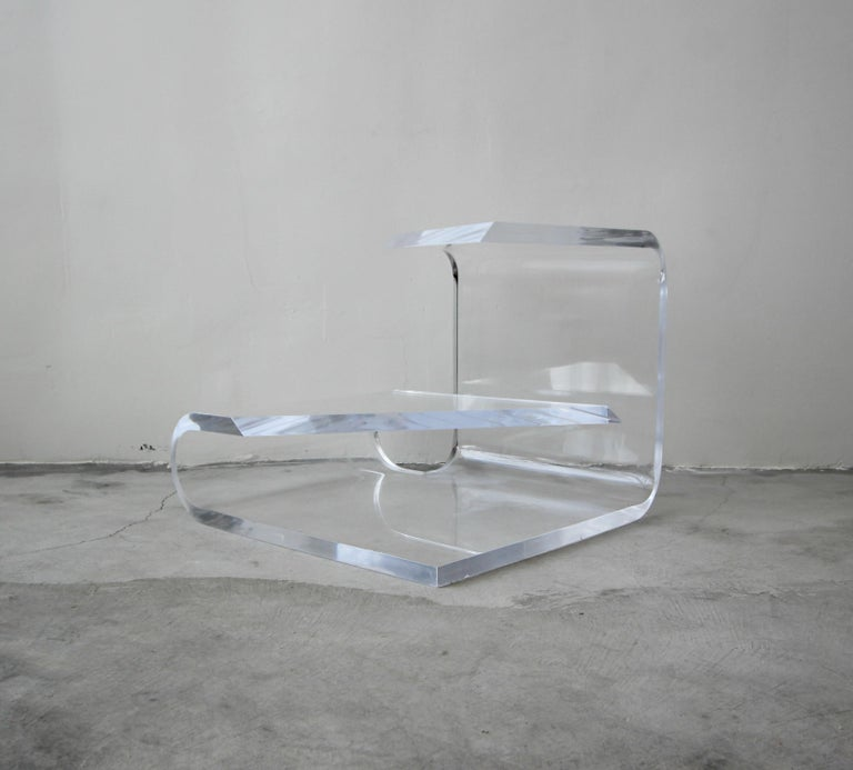 A stunning example of vintage Lucite. This two-tier 1