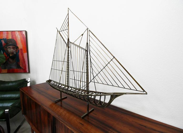 Curtis Jere Classic. This large ship sculpture can stand freely on a surface or be wall-mounted using the original, attached wall mount. Signed.