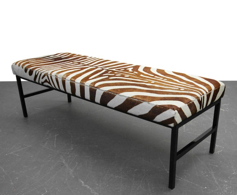 Upholstered in an authentic and rare brown zebra hide and resting upon a high gloss, powder coated base, this bench is a Minimalist punch of modern style. Looking for that one amazing detail piece to complete y our room, here it is.