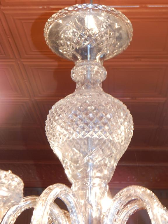 A simple, elegant Waterford style six arm chandelier.