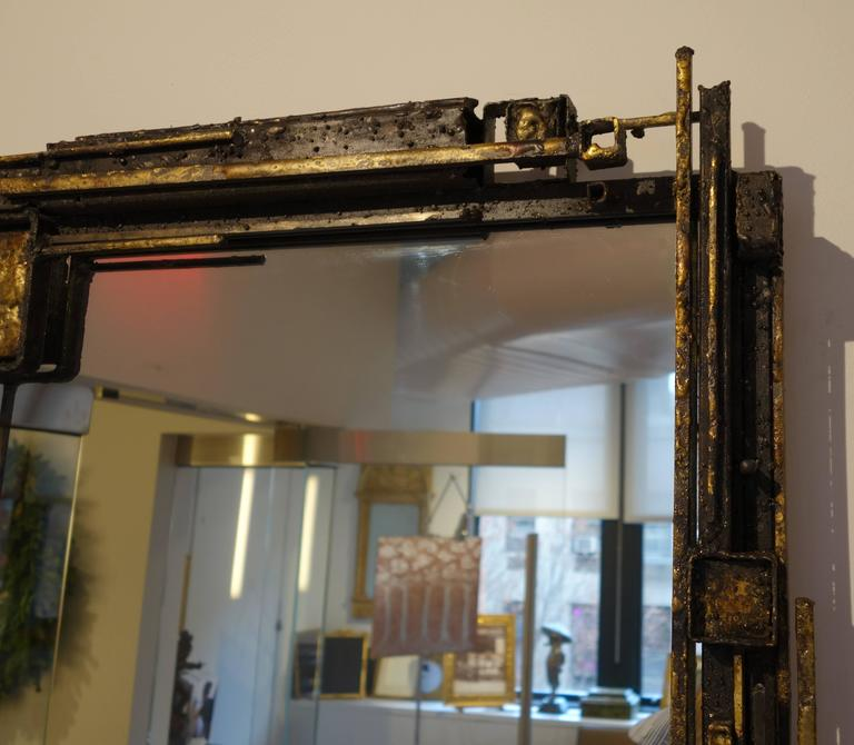 Original sculpture wall mirror by James Anthony Bearden. Patinated steel, fused bronze, clear coat and mirrored glass.