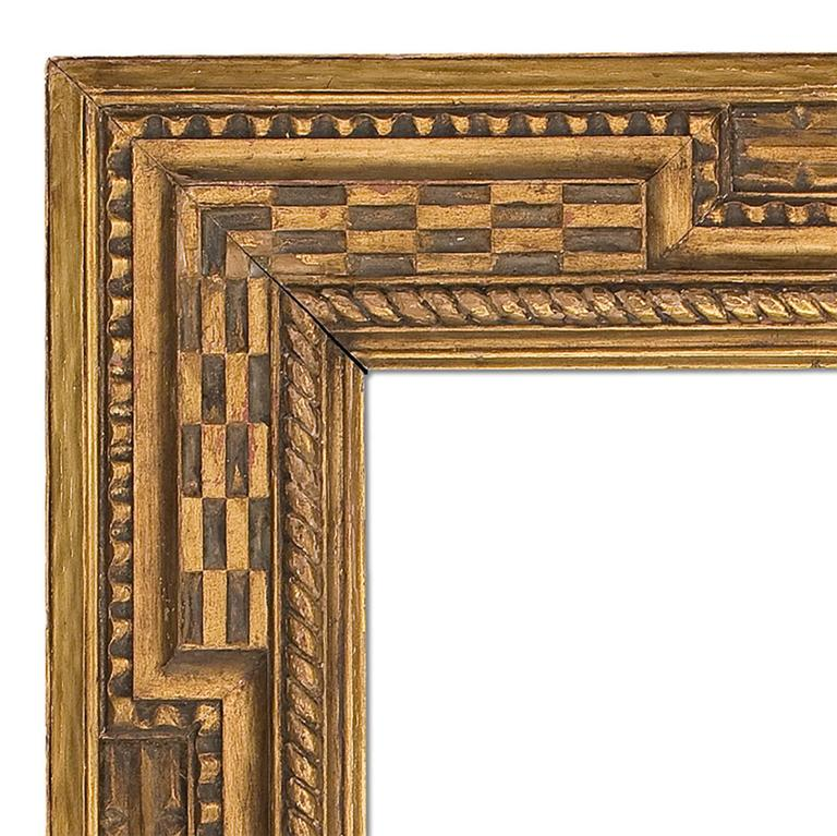 Early 20th century style Arts & Crafts carved and gilt mirror with Dutch extended corner design. Measures : 30