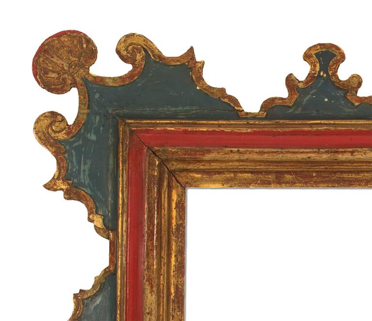 Carved and gilt mirror in the 19th century Spanish style, hand-painted and patinated. Measures: 20