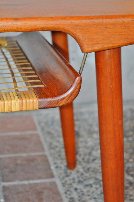 striking trioh teak coffee table curved caned shelf at 1stdibs