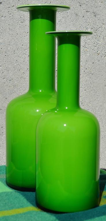 These iconic Danish Modern handblown art glass vases are in the most delicious shade of green that will be a gorgeous pop of color in your decor that will complement plants as well as nature. Designed by Otto Brauer for Holmegaard, they are in