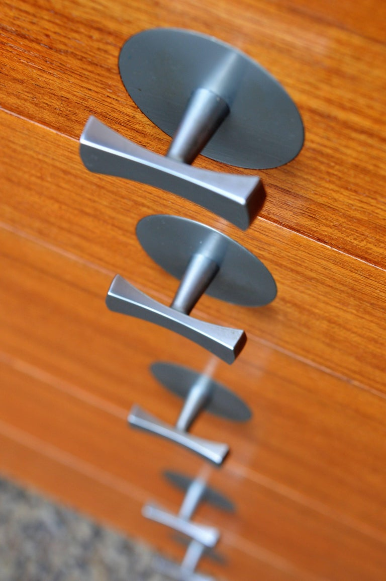 This exquisite piece is a rare design by Finn Juhl for France & Son and features his iconic bow-tie chrome door and drawer pulls and is part of the Cresco Series. Extremely well designed with top quality hardware throughout - the hinges are