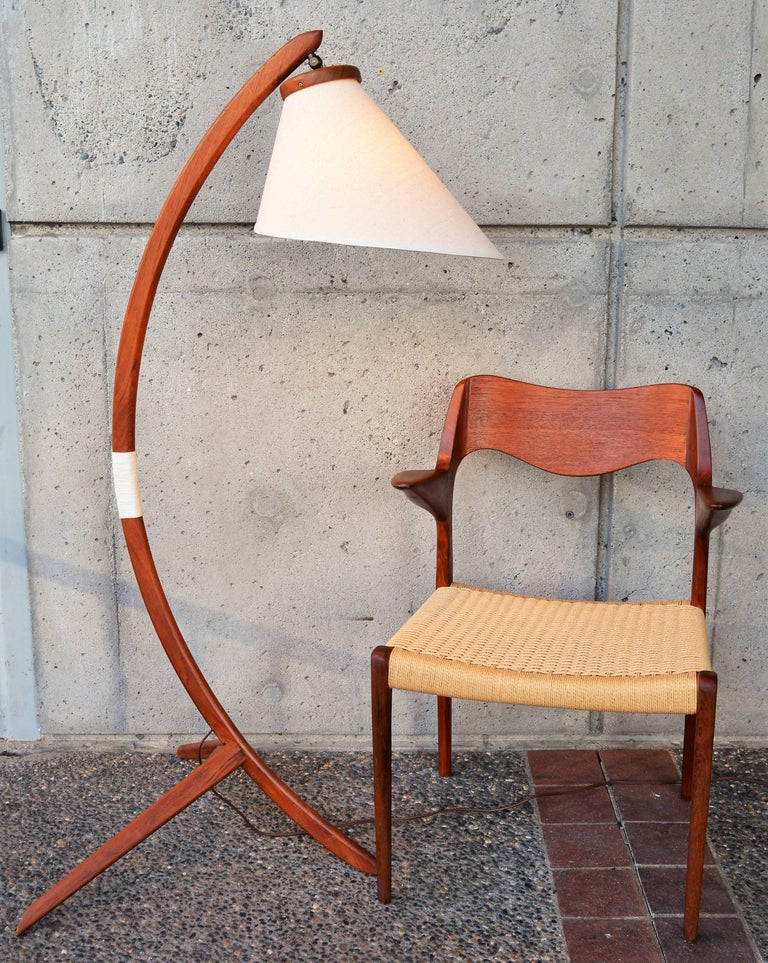 "This iconic Danish modern teak floor lamp in the style of Rispal is so dramatic and a real scene stealer! In awesome condition and freshly oiled, the lamp is nick named the ""Bow lamp"" as the main stem is designed in an arc like a bow and arrow, with"