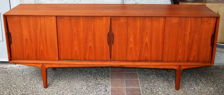 Mid-20th Century Danish Modern Knud Nielsen Teak Four Slider Credenza with Iconic Door Pulls For Sale